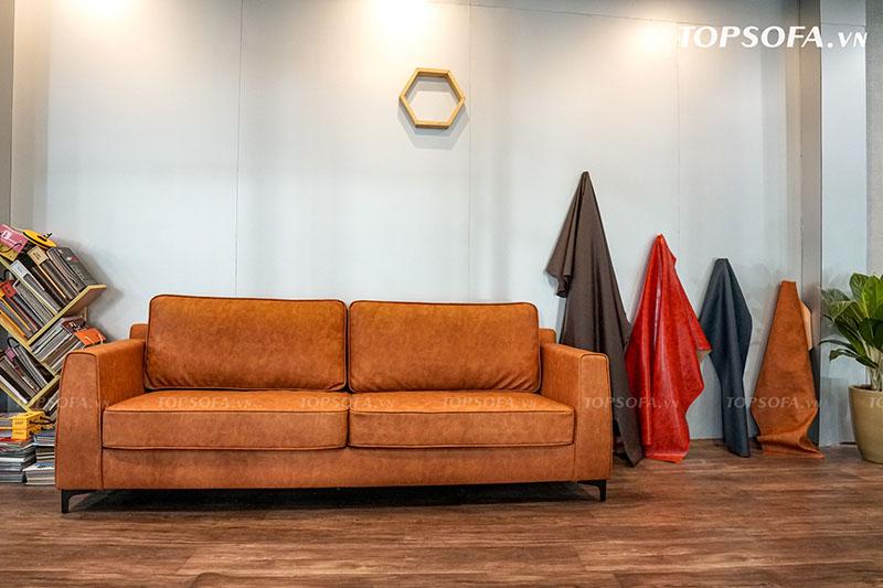 Nếu chọn sofa văng da màu nâu cho phòng khách nhỏ, bạn nên sơn tường màu xám sáng để mẫu sofa trở thành điểm nhấn nổi bật trong căn phòng