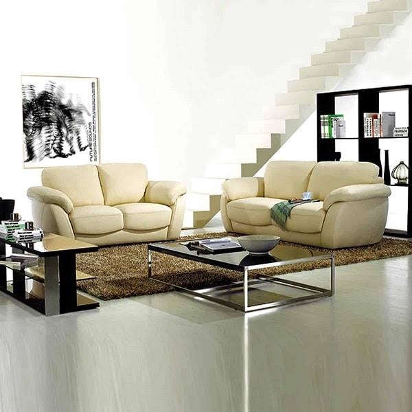 Sofa da màu vàng kem thiết kế đơn giản phù hợp với căn phòng phong cách hiện đại