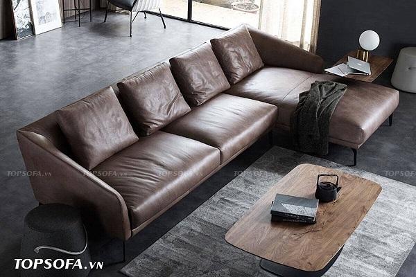 Căn phòng mang đậm màu sắc hoài cổ và hương vị cổ xưa với ghế sofa vuông hình chữ L bọc da công nghiệp Hàn Quốc màu nâu thiết kế đơn giản, nhiều đường nét góc cạnh.