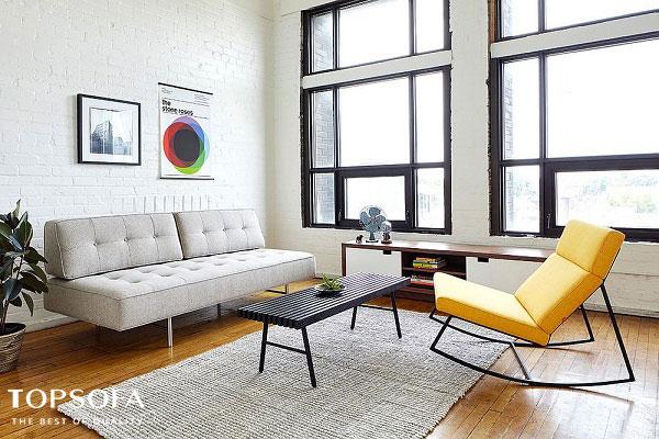 Chỉ với thiết kế đơn giản, trang nhã nhưng mẫu sofa màu trắng xám vẫn mang đến sự sang trọng cho không gian phòng khách. Đặc điểm nổi bật ở mẫu sofa văng này là không có tay tựa, chân ghế bằng inox chống han gỉ thanh thoát