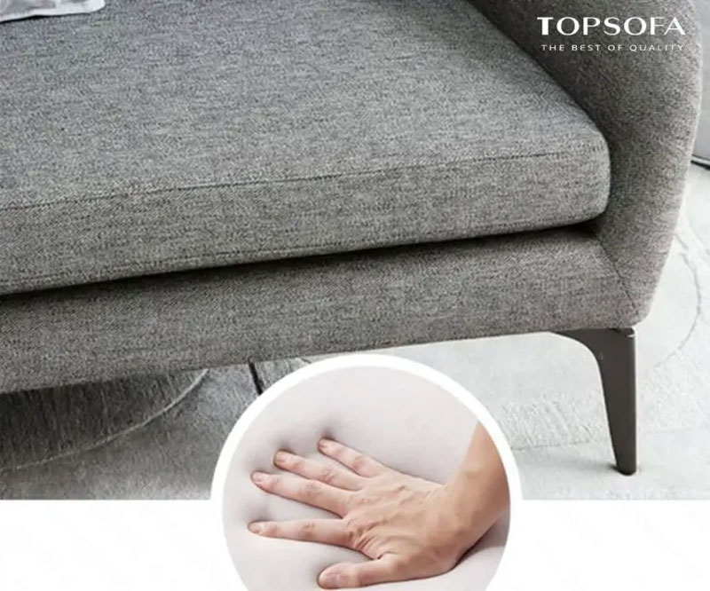 tay cảm nhận đàn hồi bề mặt sofa