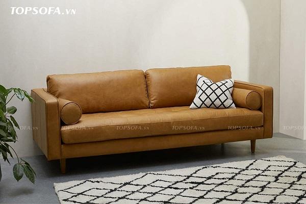 Phần đệm sofa TS322 nhấn lỗ trang trí để tạo ma sát và nổi bật sự êm ái. Hai bên tay vịn có hai phần gối đệm tròn, dài vừa như một điểm nhấn trang trí vừa là tay tựa êm ái cho người ngồi. Cùng với đó là chất liệu da màu vàng da bò cũng nâng tầng đẳng cấp cho sofa
