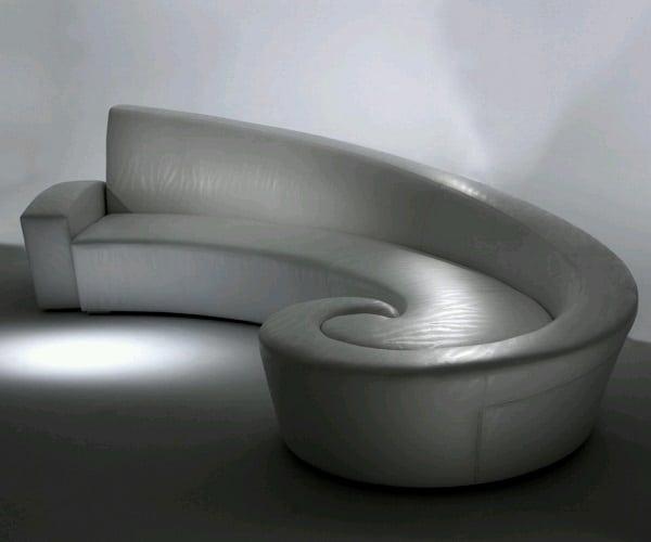 Độc đáo, phá cách và đầy sáng tạo với sofa góc tròn da hình xoắn ốc, cuộn dần về bên phải. Chất liệu da sang trọng và màu xám thanh lịch làm cho căn phòng trông càng hiện đại, đẳng cấp hơn