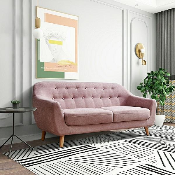 Sofa văng mini tông màu hồng ngọt ngào cùng họa tiết cúc đính lưng tựa đem đến không gian trang trí mới mẻ