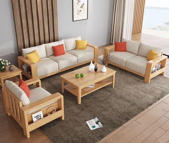Bàn ghế sofa gỗ luôn mang đến một nét đẹp riêng cho phòng khách của mỗi gia đình.