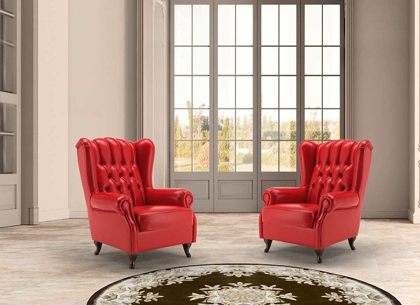 Chân ghế gỗ nâu đen tỉa cong, thiết kế hơi choãi gia vừa tăng tính thẩm mỹ vừa tạo độ chắc chắn cho ghế sofa đơn ngay cả khi người dùng ngả lưng về phía sau