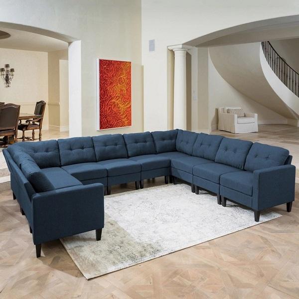 Thiết kế nhiều chân độc đáo, màu sắc tân tiến, mang lại cảm giác dễ chịu cho người nhìn. Sofa vải màu xanh góc chữ U cũng là một sự lựa chọn không tồi đối với những không gian rộng lớn, nhiều người sử dụng.