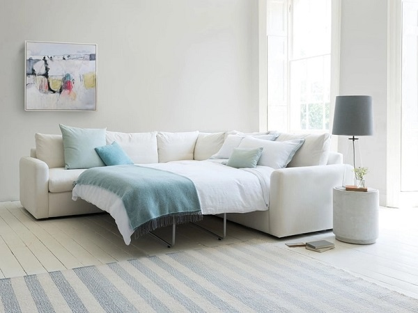 Sắc trắng sữa tinh khôi của sofa góc giường kéo đa năng không chỉ làm nên vẻ đẹp trẻ trung, hiện đại, sáng rỡ, rạng ngời mà còn làm cho căn phòng trông rộng, thoáng hơn