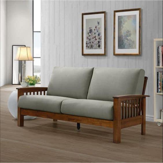 Kết hợp sofa văng gỗ 2 chỗ với đệm mút nỉ màu xám mang lại vẻ đẹp hiện đại, sang trọng cho căn phòng.