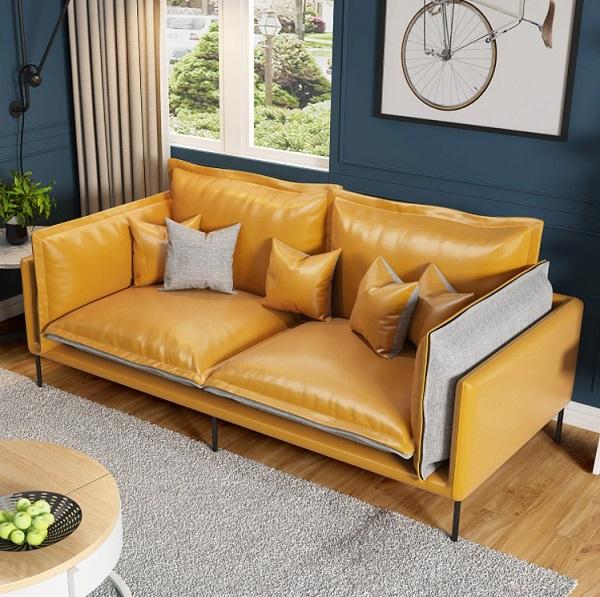 Một chiếc ghế sofa văng da – vải phối màu cam vàng – xám nhạt thế này sẽ là sự lựa chọn hoàn hảo để kê sát mép tường phòng ngủ màu xanh ghi