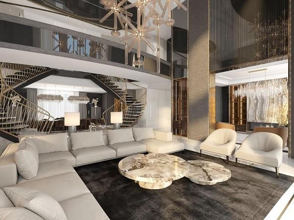 Một chiếc ghế sofa góc trắng xám khi phối cùng những chiếc góc sofa đơn cùng màu, bàn đá tròn cao cấp và bộ đèn chùm hoành tráng sẽ tạo nên góc tiếp khách đầy đẳng cấp, mang đậm không khí châu Âu