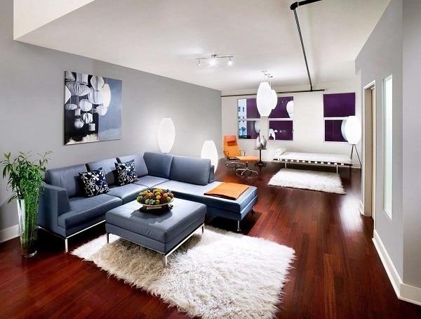 Chân nâng inox sáng bóng giúp nâng tầm đẳng cấp cho sofa góc xanh ghi, tạo dáng thanh cảnh để mẫu sofa phù hợp hơn với căn phòng khách chung cư vừa phải