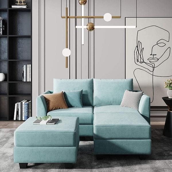 Chân gỗ sơn đen to bản, nâng cao bề mặt đệm tạo độ thoáng và vẻ vững chãi, khỏe khoắn cho sofa góc nhỏ gọn chữ V xanh da trời nhạt