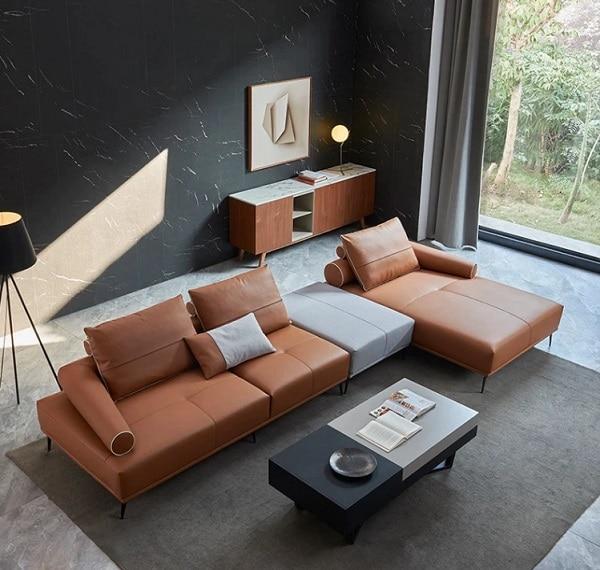 Không chỉ kết cấu, màu sắc mà sofa góc tay trứng này còn gây ấn tượng với phần lưng và tay vịn hình trụ nhỏ dần, uốn quanh ghế một cách độc đáo và sáng tạo